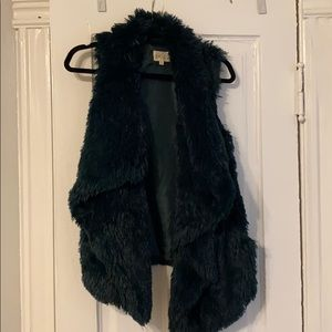 Dark green faux fur vest
